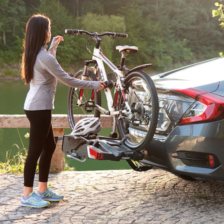 Close up of Honda Civic 4 door with bicycle carrier.
